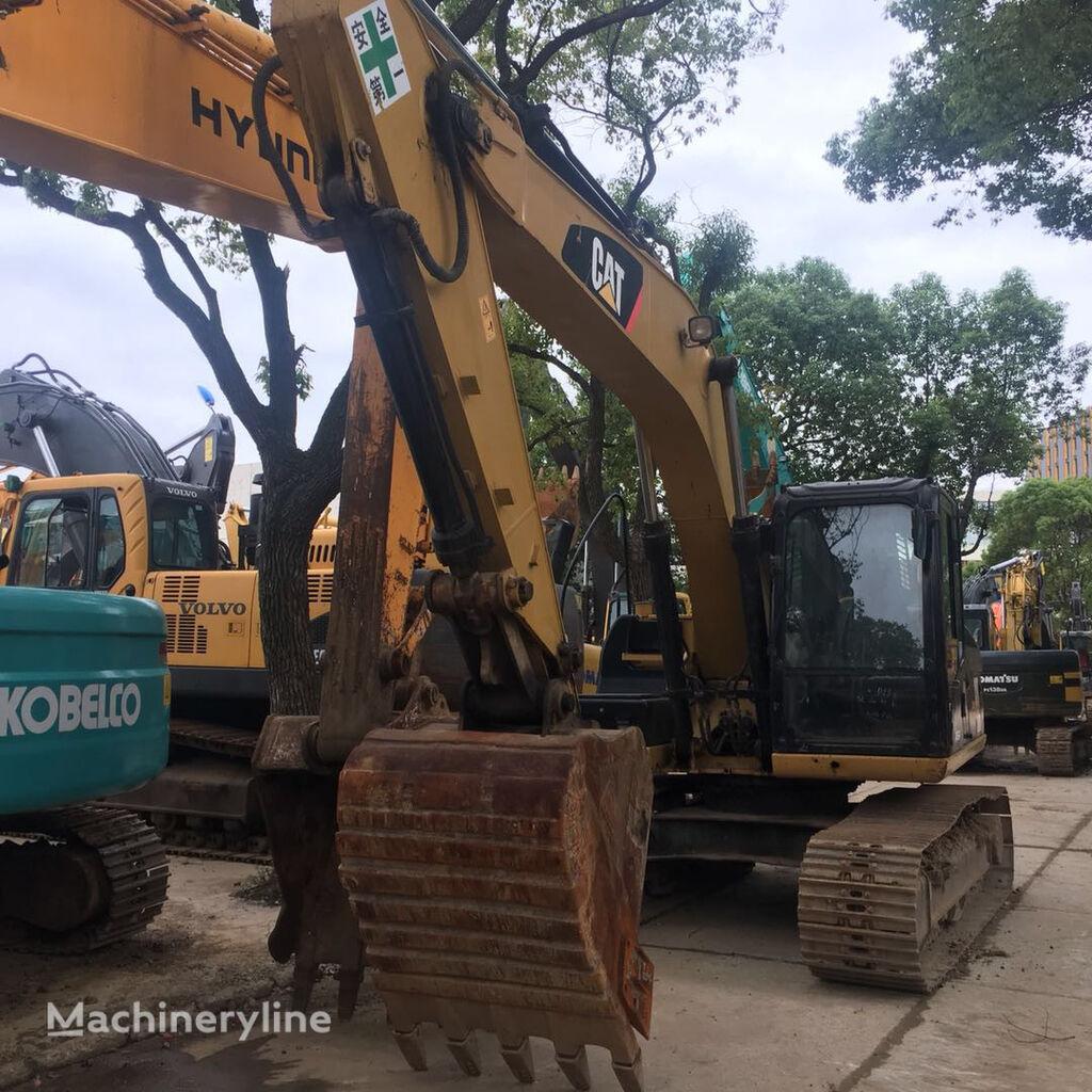 excavator dengan track CATERPILLAR 318DL